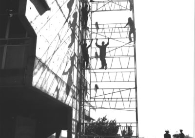 Workers climb scaffolding, while Pelindaba is under construction